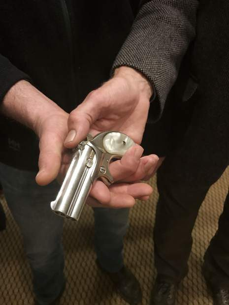 Jason Brierley and Bill Kight hold Doc Holliday's derringer. The Glenwood Springs Historical Society, where Kight is executive director, agreed to purchase the gun from Brierley on March 9, 2017.