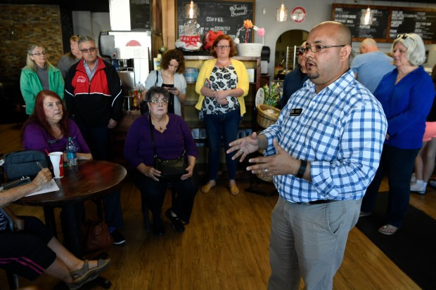Colorado Rep. Joe Salazar, D-Thornton, talks to his constituents at Delight Me Sweets March 18, 2017 in Thornton, Colorado.