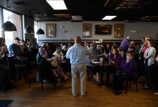 Colorado Rep. Joe Salazar, D-Thornton, talks to his constituents at Delight Me Sweets March 18, 2017 in Thornton, Colorado.