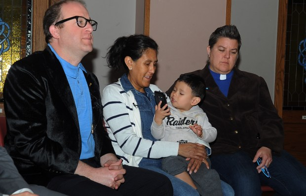 U.S. Rep. Jared Polis speaks to press along with Jeanette Vizguerra, holding her grandson Santiago Tabulla, and Reverend Anne Duncan, right, Wednesday, March 3, 2017. Vizguerra has taken sanctuary at the First Unitarian Church while facing deportation to Mexico.