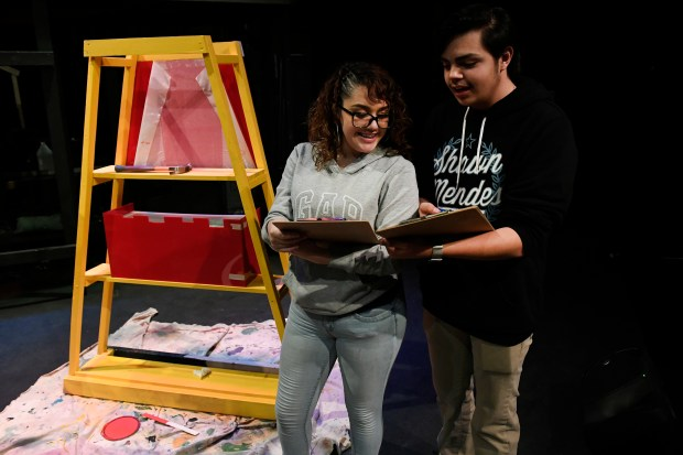 Su Teatro interns Susana Castaneda and Steven Abeyta, right, work on stage as the staff prepare for an upcoming show on March 6, 2017 in Denver.