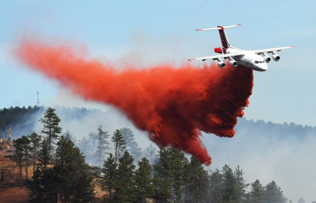Fire crews fight a wildfire from ...