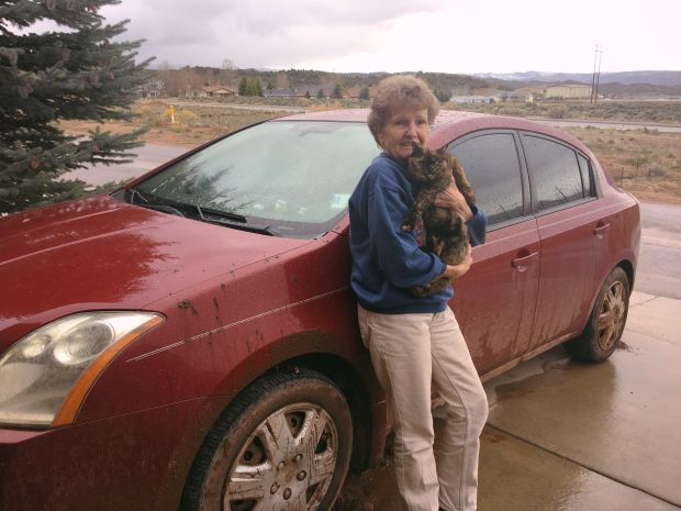 Ruby Stein, 85, is pictured with her cat Nikki and her 2007 Nissan Sentra.