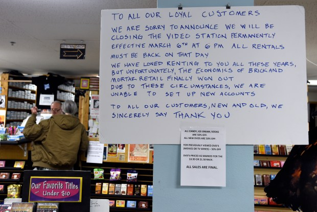A sign announcing the stores closing hangs on the wall at The VideoStation on Tuesday in Boulder. The video store's last day open for business will be Monday, March 6.
