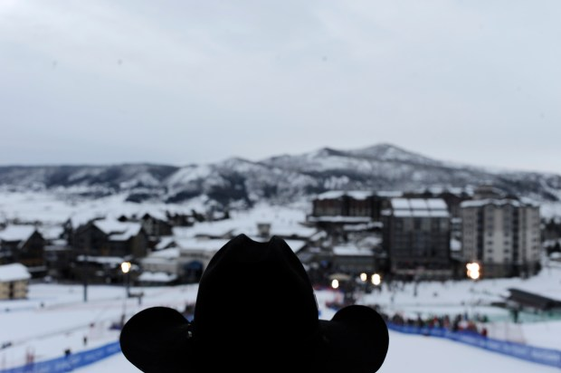 A cowboy looks out over the hill before riding down during the 37th annual Cowboy Downhill on Tuesday, January 18, 2011 at Steamboat.