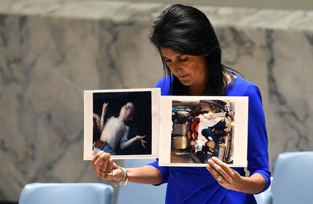 Nikki Haley, the U.S. ambassador to the United Nations, holds photos of victims of a chemical weapons attack in Syria as she speaks at the U.N. last Wednesday.