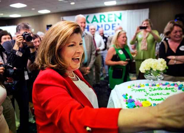 Republican candidate for Georgia's Sixth Congressional seat Karen Handel thanks supporters after being presented with a cake as her birthday is celebrated at an election night watch party in Roswell, Ga., Tuesday, April 18, 2017. Republicans are bidding to prevent a major upset in a conservative Georgia congressional district Tuesday where Democrats stoked by opposition to President Donald Trump have rallied behind a candidate who has raised a shocking amount of money for a special election. (AP Photo/David Goldman)