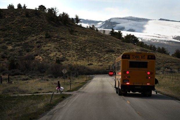 A school bus drops off children in the foothills of the Wind River Indian Reservation April 10, 2017 near Ethete, Wyo.