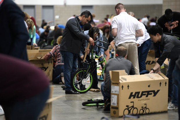 DENVER, CO - APRIL 26: DaVita's annual partner meeting brings about 4,800 employees from around the world to town. DaVita employees also took part in assembling 1,100 bikes for kids from Denver Public Schools on April 26, 2017. The bike giveaway brought many smiles to the kids and to the employees. (Photo by John Leyba/The Denver Post)