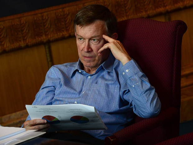 Gov. John Hickenlooper participates in a marijuana budget meeting in his office on Sept. 10, 2014.