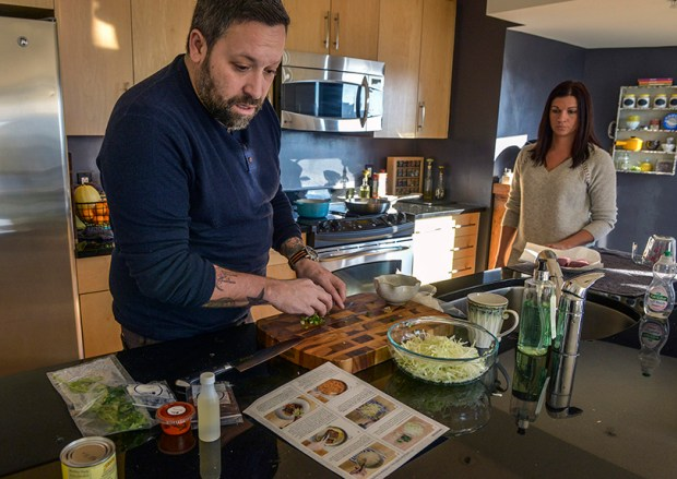 Chef Mike Isabella and his wife, Stacy Isabella, prepare a meal sent to him by Blue Apron, the online meal delivery service, in his home kitchen in Washington, D.C.