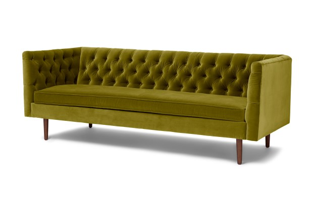 Tufted olive green velvet Chester sofa.