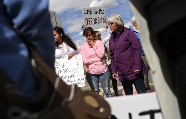 Ana Sauzameda, center, wife of Arturo Hernandez Garcia at a protest with others outside the ICE processing center on April 26, 2017 in Centennial.