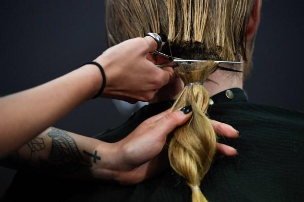 Megan Duran of Floyd's Barber cuts ...