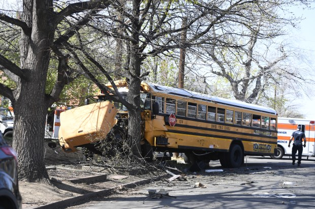 A car crashed into a Denver Public Schools bus on Thursday afternoon in northwest Denver, Thursday afternoon April 13, 2017.