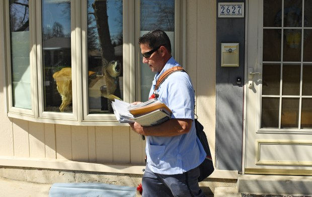 Joseph Pastorie delivers mail in the ...