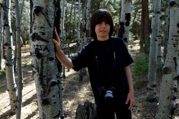 Morgan Wolfers poses for a portrait as he makes photos at Meyer Ranch Park on April 13 in Conifer.