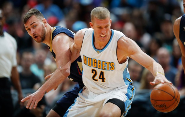 Denver Nuggets center Mason Plumlee, front, ...