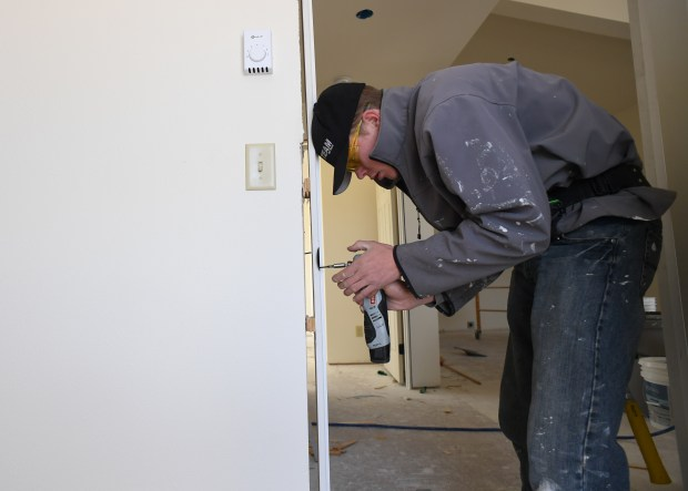 student scott freeburg ,17, works on hanging a door during construction class april 13, 2017 in westcliffe. custer county school district is seeing a teacher shortage and a lack of affordable housing so they are are building apartments for teachers in an old pre-school building that they are no longer using.