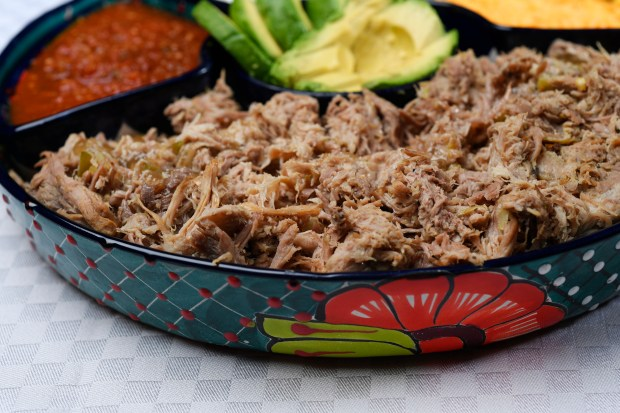 Denver Post features editor Barbara Ellis' Easy Slow cooker Pulled Pork complete with avocados, salsa, sour cream and cheese at the Denver Post studios April 11, 2017 in Denver.