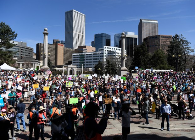 Demonstrators gather in Denver's Civic Center to demand that President Donald Trump release his tax returns on April 15.