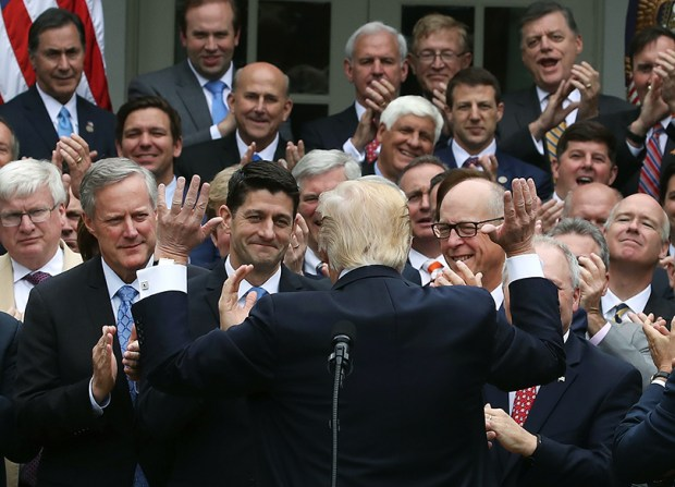 President Donald Trump congratulates House Republicans after they passed legislation aimed at repealing and replacing the Affordable Care Act during an event in the Rose Garden of the White House on May 4