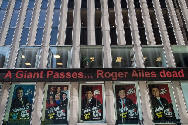 Outside the Fox News studios, a news ticker displays news of the passing of Fox News founder Roger Ailes on Thursday.