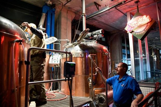 Brew Master Tom Hail checks out ...
