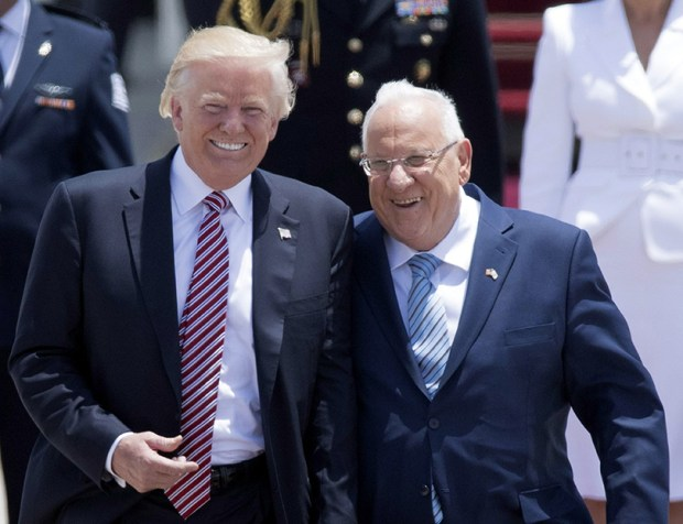 President Donald Trump and Israeli President Reuven Rivlin speak upon Trump's arrival at Ben Gurion International Airport in Tel Aviv on Monday.