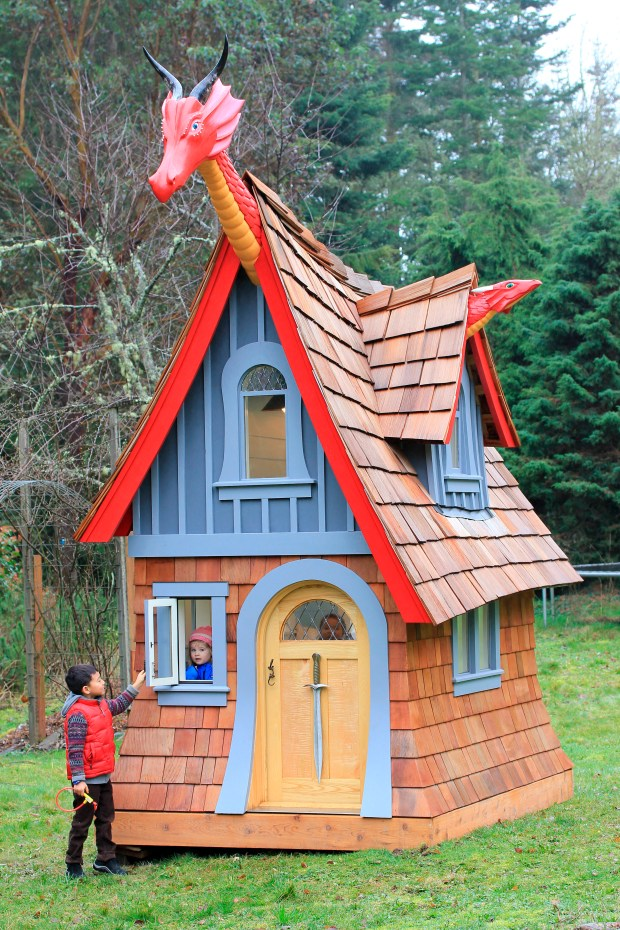 Children play in and around Magical Playhouse's 12-foot-tall, dragon-themed playhouse in Port Townsend, Wash.