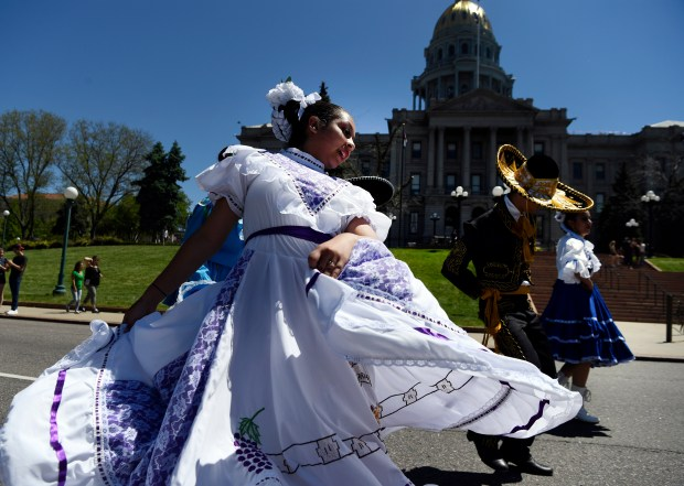 Dancers from the Noel Community Arts School perform along Lincoln Avenue in front of the Colorado Capitol during Denver's Cinco de Mayo parade on Saturday. The parade was part of the weekend Cinco de Mayo celebration in Civic Center.