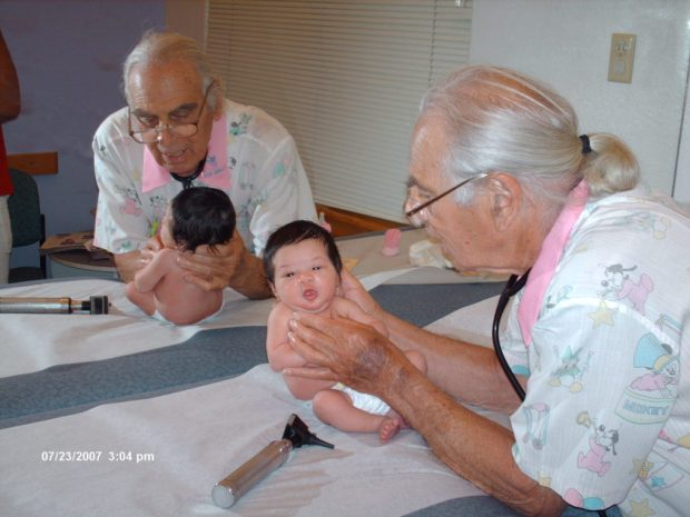 Dr. Jules Amer is shown with a patient in a photo dated July 23, 2007.