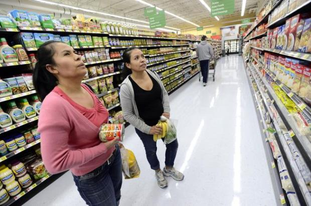 Bene Ramirez, left, and her sister Juanita shop for goods at Walmart in Boulder during the store grand opening on Oct 2, 2013. The company announced May 23, 2017 that it would close the store due to Boulder's highly competitive retail environment and the rise of online shopping.
