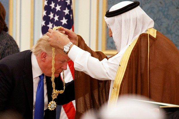Saudi King Salman presents President Donald Trump with Saudi Arabia's highest civilian honor, the Collar of Abdulaziz Al Saud, at the Royal Court Palace in Riyadh on May 20.