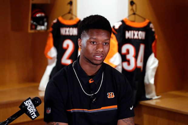 Cincinnati Bengals second-round draft pick Joe Mixon speaks during a news conference Saturday in Cincinnati. Mixon was suspended by Oklahoma University for a full season for a videotaped incident in 2014 in which he punched a woman in the face.