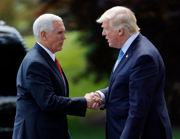 President Donald Trump shakes hands with Vice President Mike Pence last Friday before leaving for his first foreign trip.