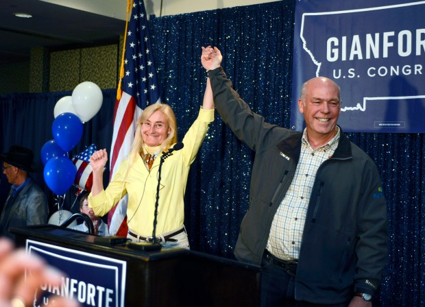Republican Greg Gianforte celebrates with his wife Susan on Thursday after winning Montana's open congressional seat. On Wednesday, Gianforte was accused of assaulting a reporter for the Guardian who had been trying to ask him a question.