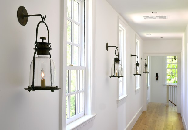 The upstairs hallway is lined with hnaging hurricane lanterns from Lars Bolander. It is shown May 10, 2017, in Harwood, Maryland.