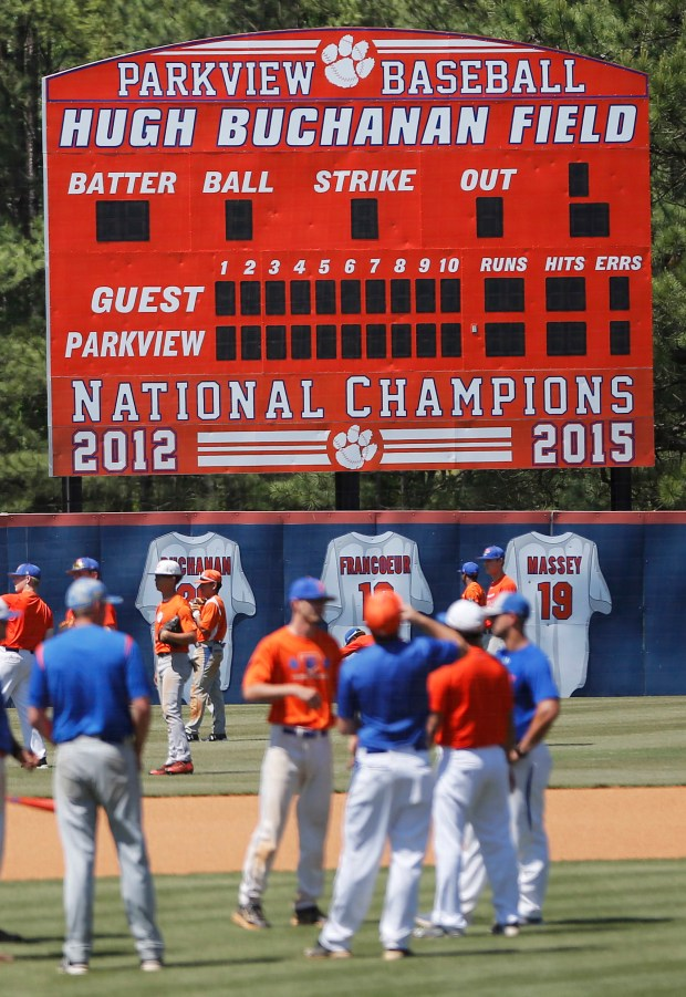 "A scoreboard touts the accomplishments of the Parkview High School baseball team as they warm up before a baseball game in Lilburn, Ga., on Wednesday, April 26, 2017. Across the U.S., perhaps nowhere is student-on-student sexual assault as dismissed or as camouflaged as in boys' sports, an Associated Press investigation found. Older Parkview players in 2015 were disciplined for sexual battery, in part, after attacking younger teammates, but the district called it ""inappropriate physical contact"" and ""misbehavior."""