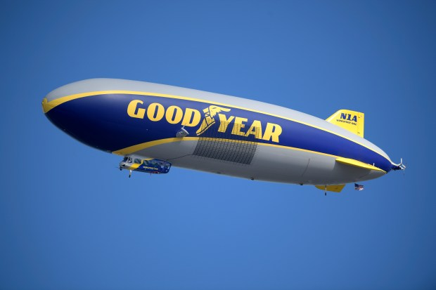 The Goodyear blimp flies over ...