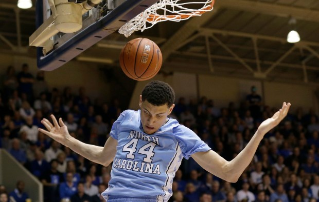 North Carolina's Justin Jackson (44) dunks against Duke during the first half of an NCAA college basketball game in Durham, N.C., Saturday, March 5, 2016. (AP Photo/Gerry Broome)