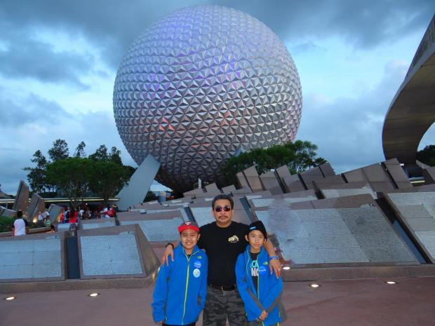 Haris Simangunsong poses with his two sons, who advocates say are U.S. citizens.