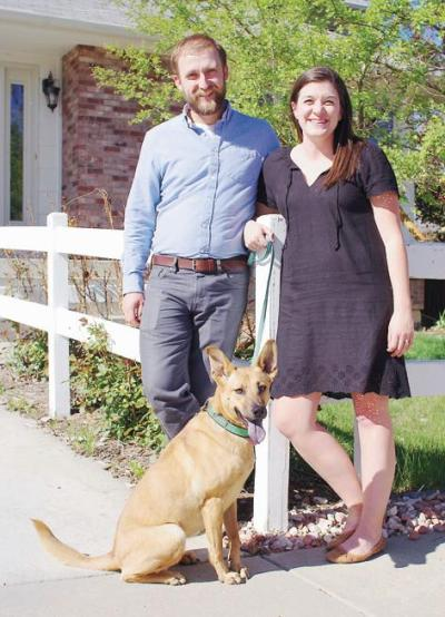 "Dana Kettlewell, right, and husband Bryan Kettlewell and dog Eliza stand in front of the southwest Loveland home they chose in the television show ""House Hunters."" Both are music teachers. Bryan teaches choir at TVHS, Dana teaches band at University Schools in Greeley."