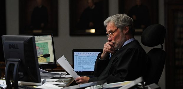 Chief Judge Robert Hyatt hears a ...