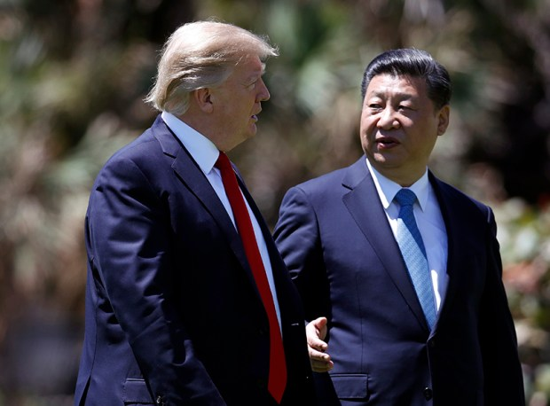 President Donald Trump and Chinese President Xi Jinping walk together on April 7 after their meetings at the Mar-a-Lago resort in Palm Beach, Fla.
