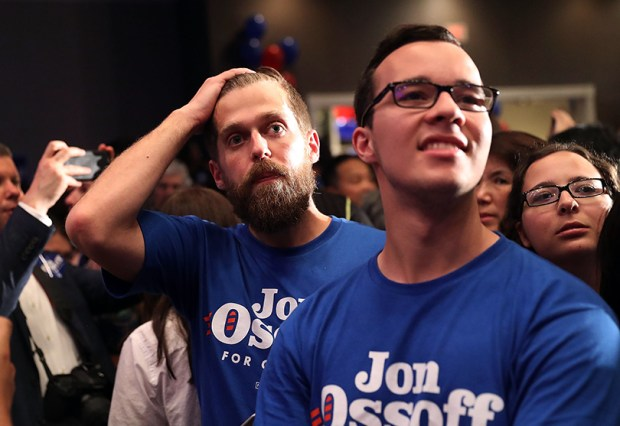 Supporters of Jon Ossoff react as election results show the Democratic candidate losing to Republican Karen Handel in last week's special congressional election in Georgia.