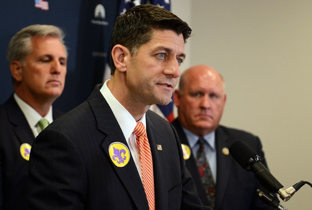 House Speaker Paul Ryan, flanked by House Majority Leader Kevin McCarthy and Rep. Glenn Thompson, R-Pa., speaks to the media at the U.S. Capitol on Wednesday, a day after Republican Karen Handel won Georgia's special congressional election.