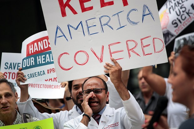Demonstrators protest Republicans' proposed changes to the Affordable Care Act on June 22 in Chicago.