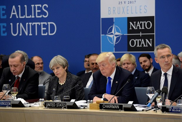 Turkish President Recep Tayyip Erdogan, British Prime Minister Theresa May, President Donald Trump and NATO Secretary-General Jens Stoltenberg look on during the North Atlantic Treaty Organization summit in Brussels on May 25.