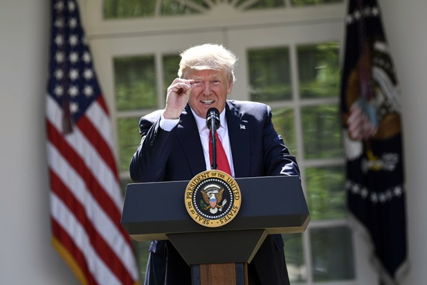 President Donald Trump announces his decision for the United States to pull out of the Paris climate agreement in the Rose Garden at the White House on Thursday.